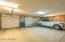 More garage space with lots of cabinets. Epoxy flooring and extended length too !!