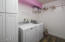 Updated laundry room with new flooring, storage & sink