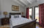 Third bedroom with private balcony.