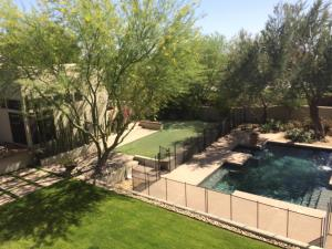 LUSH backyard with pool, spa, outdoor kitchen, 3 individual cabanas.