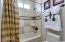 Custom shower/tub shelves built in.