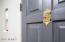 """Original Door with brass """"peep"""" door and original doorbell chime and nook."""