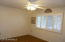 Features ceiling fan and plantation shutters.