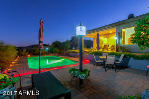 Check out the landscape lighting at night. (pool is not green)