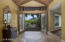 Enter through this impressive entryway with vaulted ceiling.