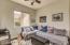 Custom shades, wood flooring, closet and ceiling fan