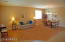 Spacious living area/great room as you enter, upgraded with durable laminate flooring.