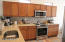 Quartz counter tops with tile back splash, stainless steel appliances
