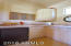 Ramada kitchenette with refrigerator ,sink and cabinets for storage