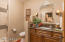 Guest Bath has impressive tile shower, New cabinets and Granite