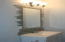 Hall Bath Vanity with Custom Mirror