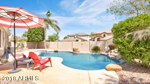 A beautiful fenced pool and spa will be a great place for summer swim parties