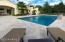 gorgeous pool is surrounded by gorgeous pool deck, lush green grass, mountain views, what more could you need!