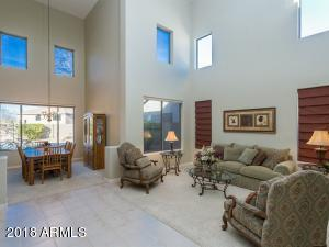 Soaring ceilings in this formal living area!