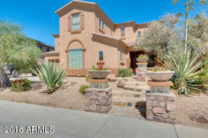 Beautiful curb appeal welcomes you to this desirable Westwing Mountain home.