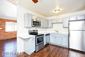 Kitchen with range, built-in microwave, dishwasher, and refrigerator.