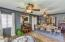 Formal living/dining with parquet flooring and coved ceilings