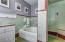 Guest bath with beautifully maintained original tile