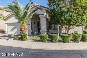 Spacious corner lot with lush landscaping and great curb appeal.