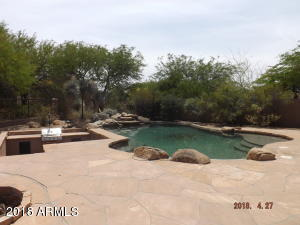Pool with sunken BBQ girll area next to it. Common area behind no neighbors