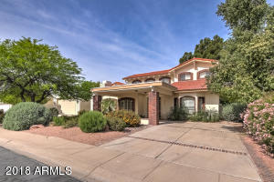 This estate is surrounded by an exclusive neighborhood and lush mature landscaping.