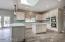 Kitchen has plenty of storage space and a nice island.