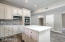 New Relic White cabinetry, & finished with Carrara Nero Marble backsplash from Italy