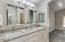 Bathrooms have spared no expense! River-White Granite slab counters. Upgrd Lighting and Hardware
