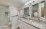Upgrd Hans Grohe Faucets, White beveled Subway Tile and Backsplash in Herrigbone pattern.