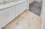 Tumbled & Sealed Travertine Flooring thoughout home, Bath has mosaic tile inlay