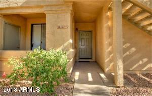 #1325 GROUND LEVEL ENTRY WITH ASSIGNED COVERED PARKING JUST STEPS AWAY!