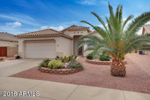 North/South Exposure. Beautiful Desert Landscaping. All Tile Roof. Security Screen Door.