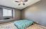 BEDROOM W/ VAULTED CEILING, CEILING FAN AND READING NOOK.