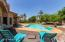 RESORT STYLE BACKYARD WITH MANY DINING AREAS. PAVERS SURROUNDING THE HOUSE