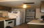 Kitchen with newer DW, Disp, Refrig.--Pantry at far end
