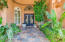 Magnificent Entry with Canterra Iron Doors, Stone Walkway and Lush Landscaping!