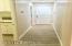 Hallway to Laundry, Storage Room and Garage.