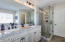 Separate tub and show in the master bath along with high counters and double sink