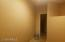 This is inside closet at end of media room, bonus room. THis wall removed would make this a large room. May have been intended for elevator.