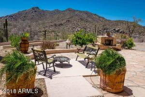 Stunning Black Mountain helps showcase the spacious backyard entertaining area.