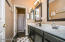 Bathroom with double sinks, bath, and shower
