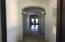 Arched Hallway to Greatroom