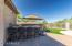 Built-in BBQ and outdoor kitchen with bar seating includes offset umbrella!