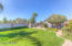Nice luscious backyard with plenty of grass for kids or dogs to play.