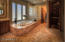 Master bath has soaking tub, walk-in shower, his and her sinks, and a private commode room.