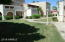 GRASSY FRONT AREA W/ MATURE LANDSCAPING & BEAUTIFUL SHADE TREE