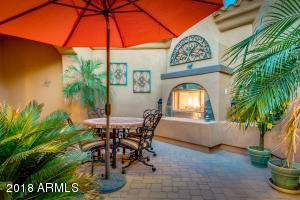 Grand courtyard entry with fireplace welcomes you home!