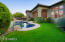 Sprawling Backyard with grass and Desert Landscape