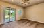 Master bedroom with door to large covered patio in backyard.