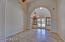 Custom iron light, diagonally set stone at entry, living room and dining room